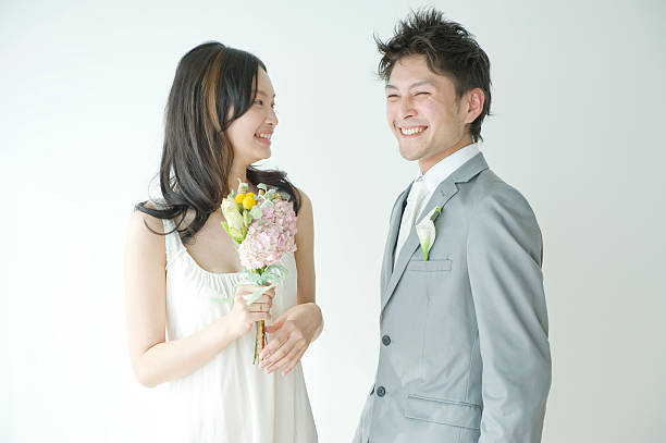 Young couple smiling face t...