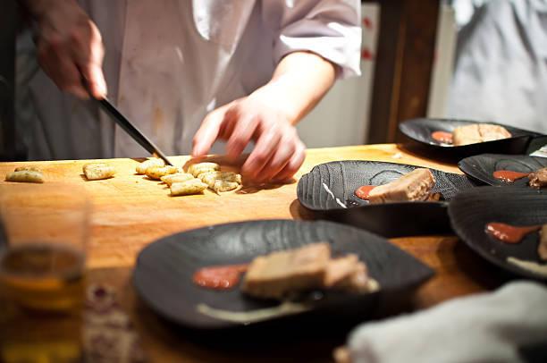 Chef preparing food in Japa...