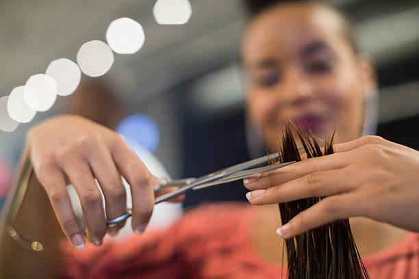 Close up hairstylist cuttin...