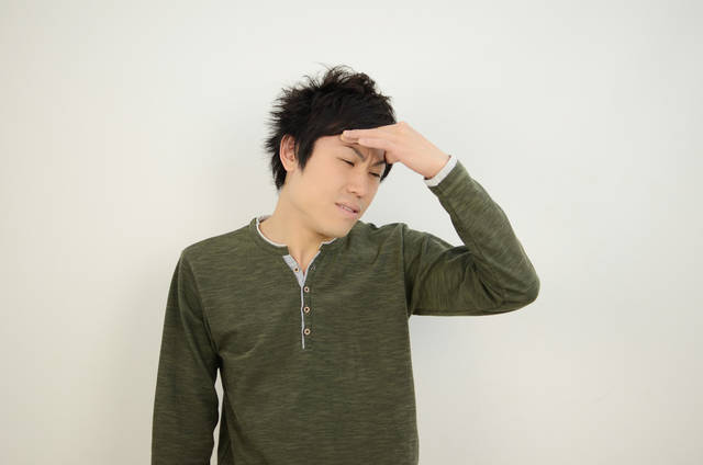 写真素材 足成:頭が痛い (11631)