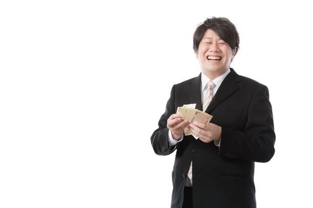 秒速で札束をカウントする銀行職員|フリー写真素材・無料ダウンロード-ぱくたそ (12421)