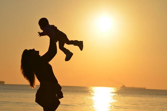 Woman Carrying Baby at Beach during Sunset · Free Stock Photo (13203)