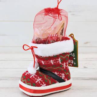 温かみのあるニット素材のブーツにお菓子を詰めました。ツ...