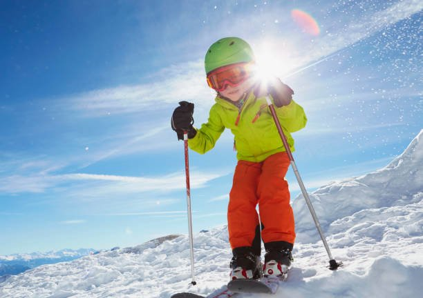 Young boy skiing downhill, ...