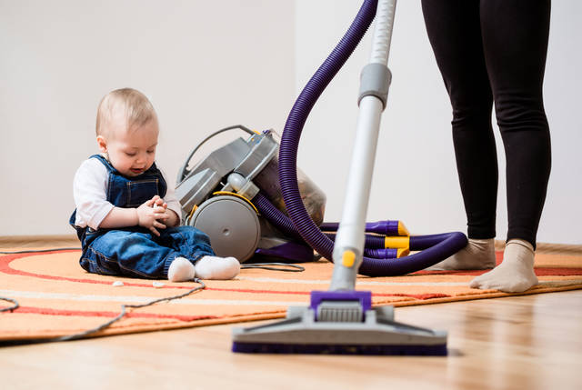 Cleaning Up The Room - Woman With Vacuum Cleaner, Baby Sitting On Floor Stock Photo 492608269 : Shutterstock (30538)