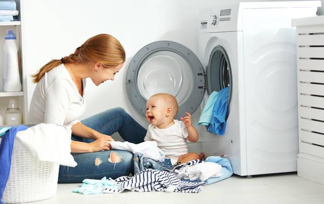 Mother A Housewife With A Baby Engaged In Laundry Fold Clothes Into The Washing Machine Stock Photo 486515626 : Shutterstock (30539)