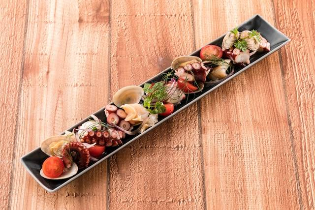 「タコと魚介のマリネ」850円(税別)