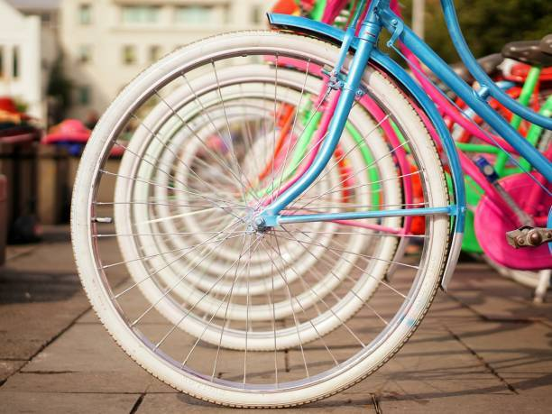 Colorful Bicycles Parked In Row On Footpath