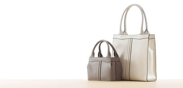 写真左からハンドバッグ『パンチ』 16万1700円、トートバッグ『パンチ・ショッピング』 11万5500円 ※タイトルに入っている「Nero e Bianco」は現在販売を中止しております。