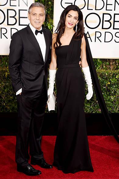 <strong>Amal Clooney|アマル・クルーニー</strong><br><br>豊かなロングヘアにハリー・ウィンストンのドロップイヤリングがよく似合う。<br>