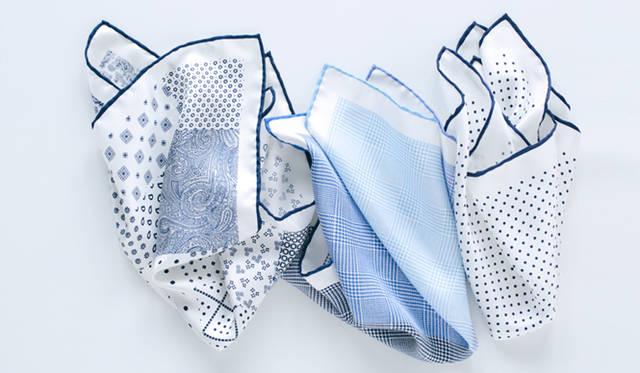 フェアファクスのポケットチーフは、バリエーションもさまざまだ。白地のシルク素材をベースとして、ペイズリーや小紋、グレンチェックといった柄を4面で切り替えたものなど、アイテムの特性を理解したデザインに、ブランドのドレスクロージングへの深い理解が感じられる