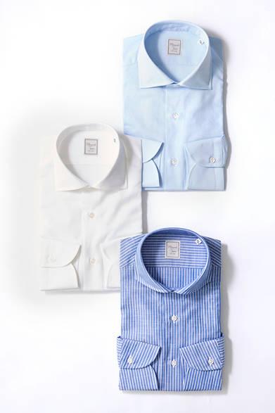 <strong>HITOYOSHI|ヒトヨシ</strong><br><br>清涼感のあるコットン×リネンのシャツは、夏のスーツスタイルのインナーとしてうってつけ。楽な着心地に加え、ドライタッチで涼やかな肌触りを約束。タイドアップならきちんとした印象のワイドカラーが、ノータイで着こなすなら、いまどきな雰囲気のあるカッタウェイがおすすめ。 <br><br> シャツ各1万1880円 [阪急メンズ限定](ヒトヨシ|阪急メンズ東京 地下1階/阪急メンズ大阪 1階)