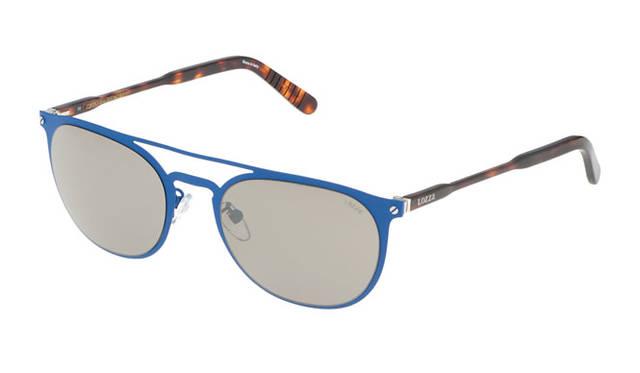<strong>LOZZa ロッツァ</strong><br />2015年春夏コレクション/海の色を思い起こさせるブルーのメタルフロントに細いプラスチックのテンプルを組み合わせた、軽量なサングラス。細いテンプルとスチールのフレームが効果的にミックスされ、モダンながらもレトロな雰囲気を醸し出している。「BASSANI(SL2235 col.RD5X)」2万5920円