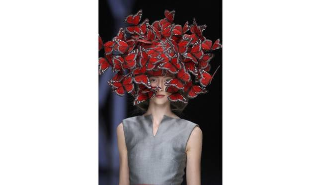 Butterfly headdress of hand-painted turkey feathers   Artist: Philip Treacy for Alexander McQueen  Date: La Dame Bleue,S/S 2008  Credit line: Model: Alana Zimmer, © Anthea Simms  Special terms: None