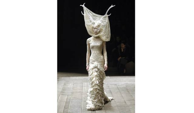 Tulle and lace dress with veil and antlers  Artist: Alexander McQueen  Date: Widows of Culloden, A/W 2006–07  Credit line: Model: Raquel Zimmermann, Viva London, Image: firstVIEW