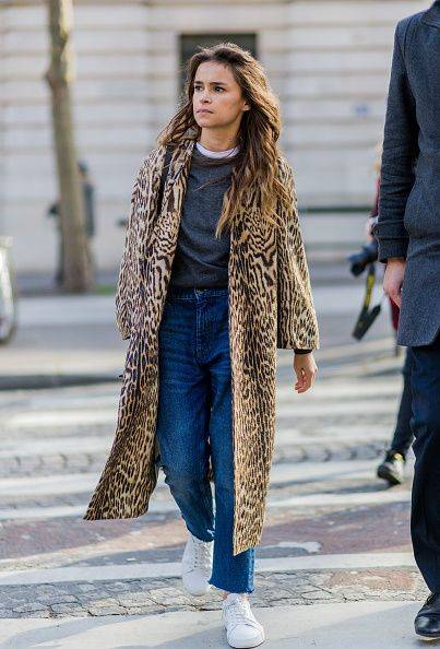 Miroslava Duma wearing a coat with leopard print denim jeans and white sneakers outside Balmain during the Paris Fashion Week Womenswear Fall/Winte… | Pinteres… (49933)