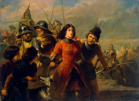 Joan of Arc hold by soldier...