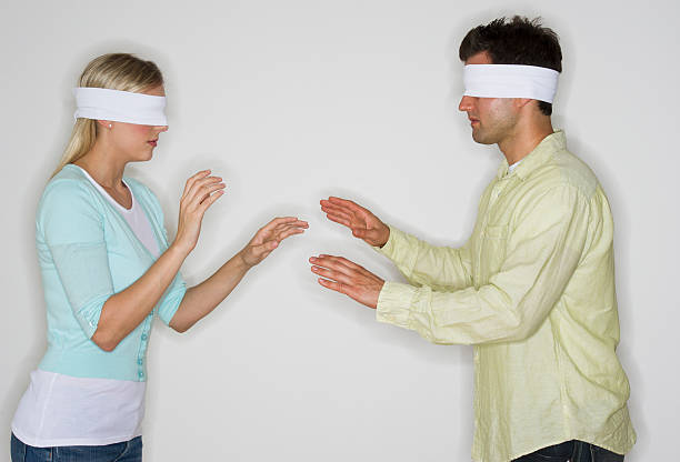 Blindfolded couple looking ...