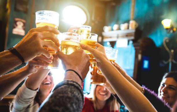 Friends Toasting Beer In Re...