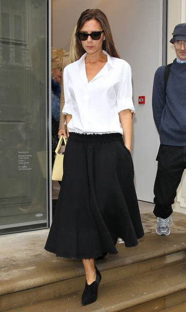 Work Outfit Inspiration: Victoria Beckham's White Button-Down Shirt and Black Midiskirt | Glamour (46243)