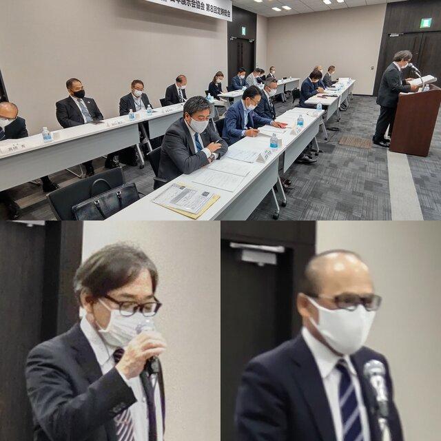 議案進行する越野副会長と監査報告する高橋監事